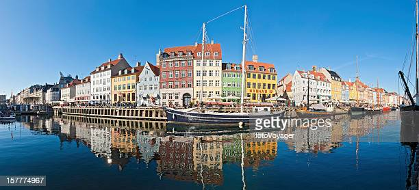 Copenhagen Nyhavn bars vibrant villas reflected