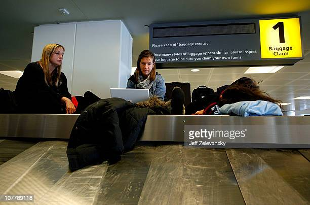 Copenhagenbound travelers Jill Jedrusiak Zoe Bergeal and Adela Sejdija camp out atop a baggage conveyor at Terminal B following a major blizzard that...