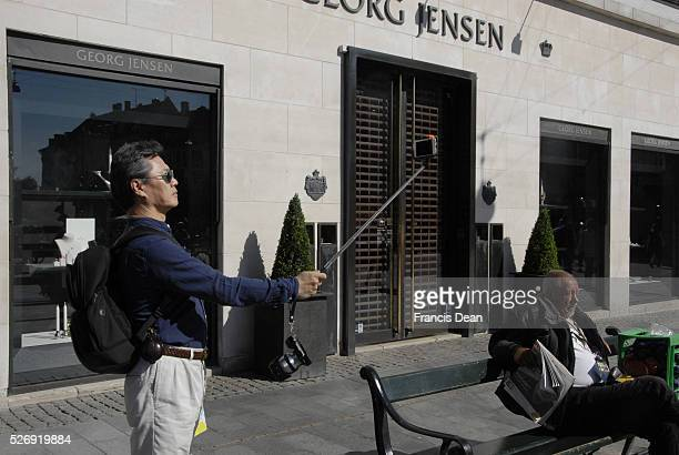 Copenhagen/Denmark/ 23 August 2015_Traveler making selfie on strogoet on pedestrain street