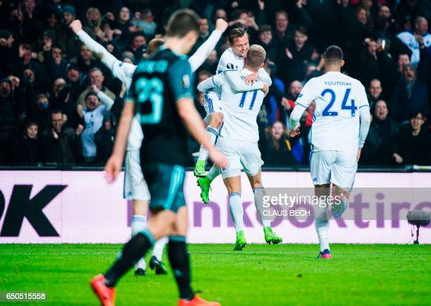 Copenhagen's Andreas Cornelius celebrate after scoring the 21 goal with his teammates during the UEFA Europa League Round of 16 first leg football...