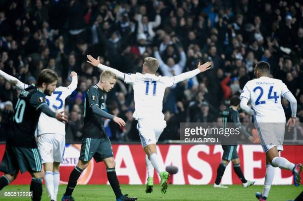 Copenhagen's Andreas Cornelius celebrates after scoring the 21 goal during the UEFA Europa League Round of 16 first leg football match FC Copenhagen...