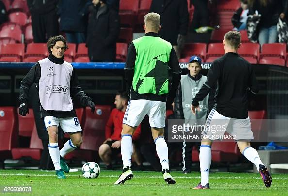 FC Copenhagen's Danish midfielder Thomas Delaney and his teammates warm up prior to the UEFA Champions League group G football match between FC...