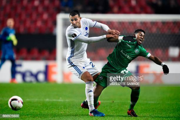 FC Copenhagen's Danish midfielder Youssef Toutouh and Ludogorets' Dutch forward Virgil Misidjan vie for the ball during the UEFA Europa League round...