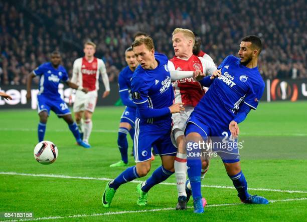 Copenhagen's defender Ludwig Augustinsson vies with Ajax Amsterdam's defender Matthijs de Ligt during the UEFA Europa League Round of 16 second leg...