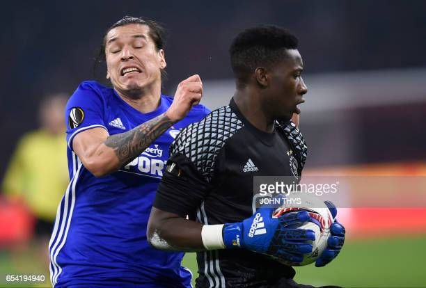 Copenhagen's forward Frederico Santander vies with Ajax Amsterdam's goalkeeper Andre Onana during the UEFA Europa League Round of 16 second leg...