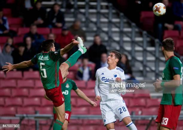 FC Copenhagen's forward from Cyprus Pieros Sotiriou vies with Lokomotiv Moscow's defender from Serbia Nemanja Pejcinovic during the UEFA Europa...