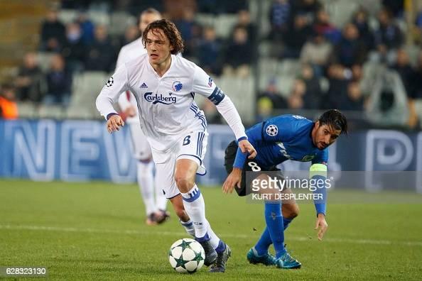FC Copenhagen's midfielder Thomas Delaney evades and Club Bruges' Israeli midfielder Lior Refaelov during their UEFA Champions League football match...