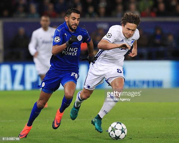 Copenhagen's midfielder Thomas Delaney tackles Leicester City's midfielder Riyad Mahrez during their Champions League Group G soccer match at the...