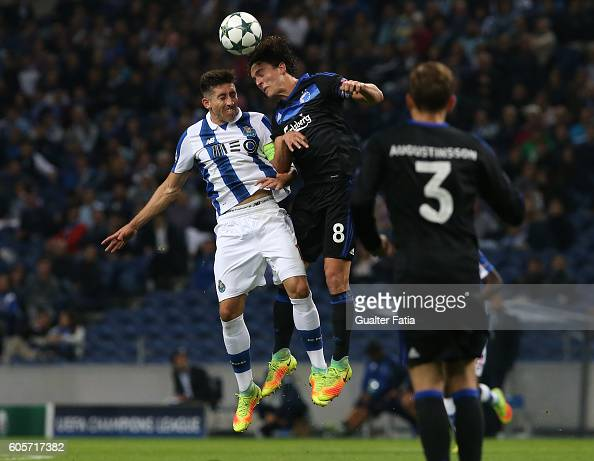 Copenhagen's midfielder Thomas Delaney with FC Porto's midfielder from Mexico Hector Herrera in action during the UEFA Champions League match between...