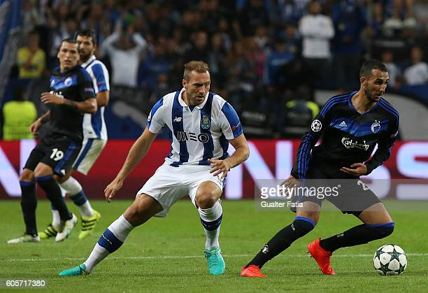Copenhagen's midfielder Youssef Toutouh with FC Porto's forward from Belgium Laurent Depoitre in action during the UEFA Champions League match...
