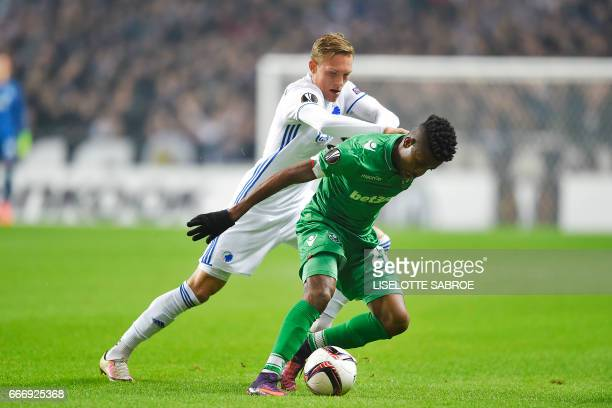 FC Copenhagen's Swedish defender Ludwig Augustinsson and Ludogorets' Brazilian forward Jonathan Cafu vie for the ball during the UEFA Europa League...