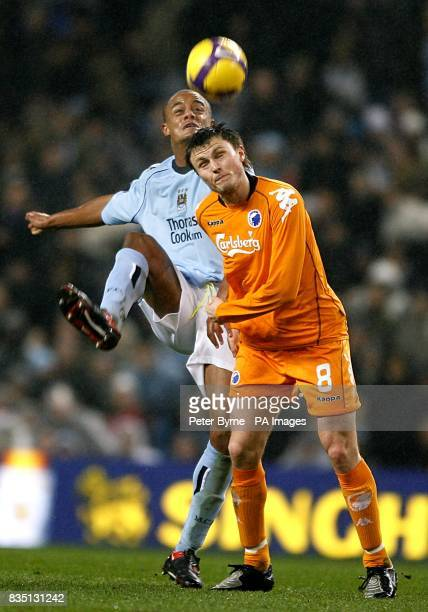 FC Copenhagen's William Kvist and Manchester City's Vincent Kompany battle for the ball