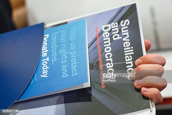 A copie of the 'Surveillance and Democracy' report is shown during Professor Joseph Canatacci speech the UN special Rapporteur on Privacy a part of...