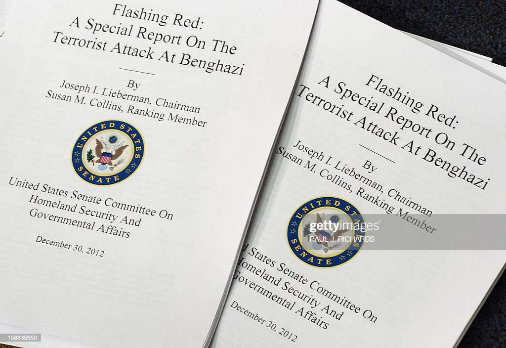 Copies for distribution of the US Senate Committee on Homeland Security and Governmental Affairs report, ' Flashing Red: A Special Report On The Terrorist Attack At Benghazi.' are seen December 31, 2012 during a press conference on Capitol Hill in Washington, DC. The scathing report faults the US State Department for failing to provide security in light of mounting threats leading up to the assault. The report says the facility was woefully under-protected at a time when the region, according to a top department official, was 'flashing red' yet, security was not improved and there was no recommendation to close the compound. The report also placed fault with the White House and the Pentagon. AFP PHOTO/Paul J. Richards