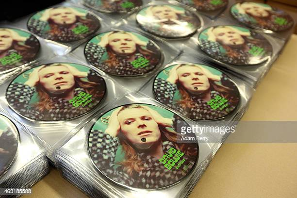 Copies of a 7' picture disc of David Bowie's 'Changes' lie prior to packaging at the Optimal record plant on February 11 2015 in Roebel Germany...