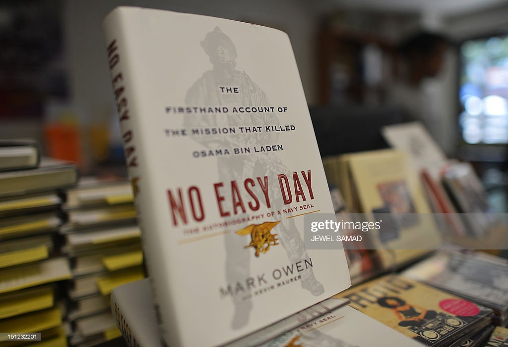 Copies of a book by former Navy SEAL tittled 'No Easy Day' are seen on display at a bookstore in Washington, DC, on September 4, 2012. The Pentagon said Tuesday the new book by a former Navy SEAL on the raid that killed Osama bin Laden contains classified information, an allegation that could expose the author to prosecution. The Defense Department has already threatened legal action over 'No Easy Day,' which went on sale in book stores Tuesday, but officials had previously stopped short of saying whether the book had revealed state secrets.AFP PHOTO/Jewel Samad