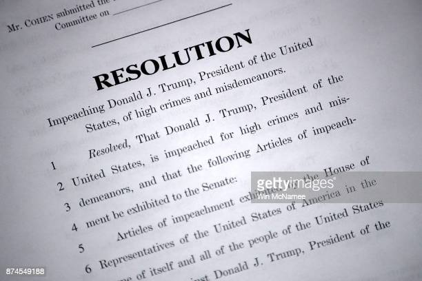 Copies of Articles of Impeachment introduced by Rep Steve Cohen are shown during a press conference at the US Capitol November 15 2017 in Washington...