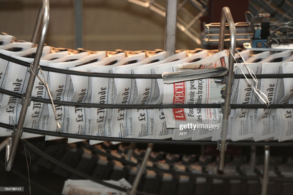 Copies of French daily newspaper 'Le Monde' are pictured in the printing house of 'La Depeche du Midi', the southwestern newspaper on October 25, 2012 in Toulouse. Part of the Le Monde newspaper production is now printed in Toulouse and is now available in the city at midday instead of the following morning.