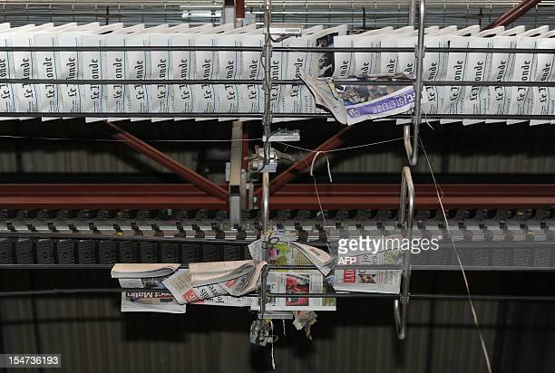 Copies of French daily newspaper 'Le Monde' are pictured in the printing house of 'La Depeche du Midi' the southwestern newspaper on October 25 2012...