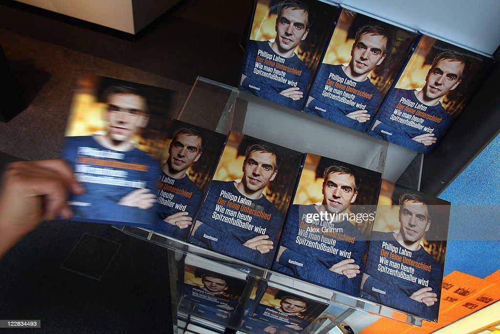 Copies of German football player <a gi-track='captionPersonalityLinkClicked' href=/galleries/search?phrase=Philipp+Lahm&family=editorial&specificpeople=483746 ng-click='$event.stopPropagation()'>Philipp Lahm</a>'s book 'Der feine Unterschied' are displayed in a book store on August 29, 2011 in Frankfurt am Main, Germany.