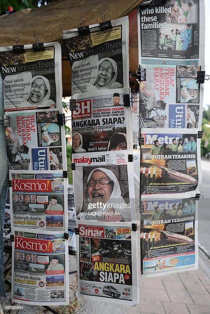 Copies of Malaysian newspapers with reports about the Malaysia Airlines flight MH17 crashed in eastern Ukraine are seen at a shop in Kuala Lumpur on July 19, 2014. Malaysia Airlines Flight MH17 carrying 298 people from Amsterdam to Kuala Lumpur crashed on July 17 in rebel-held east Ukraine, as Kiev said the jet was shot down in a 'terrorist' attack.