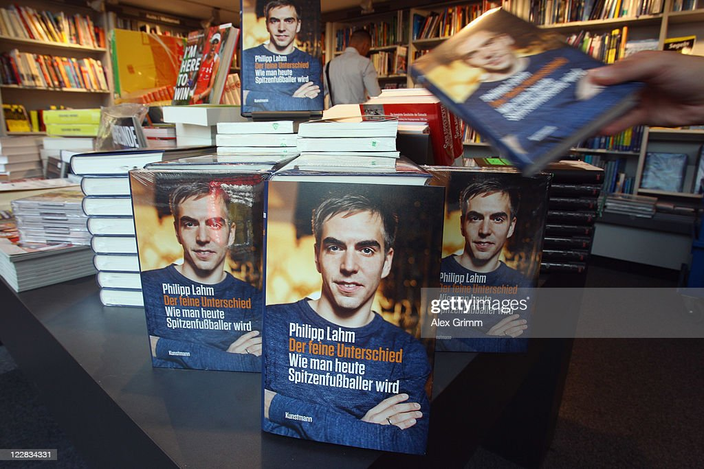 Copies of <a gi-track='captionPersonalityLinkClicked' href=/galleries/search?phrase=Philipp+Lahm&family=editorial&specificpeople=483746 ng-click='$event.stopPropagation()'>Philipp Lahm</a>'s book 'Der feine Unterschied' are seen in a book store on August 29, 2011 in Frankfurt am Main, Germany.