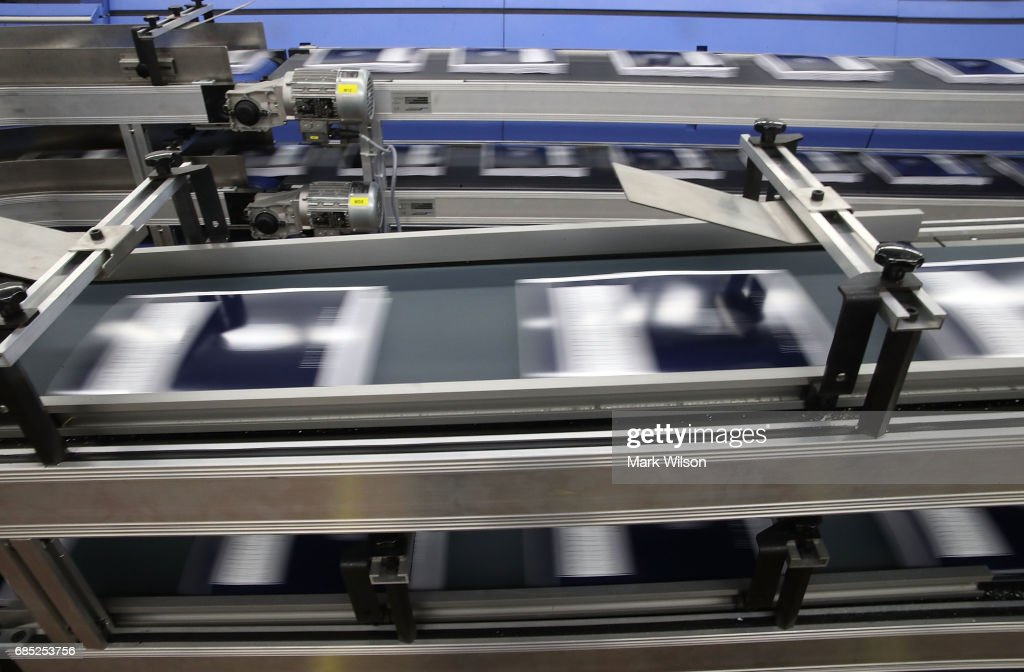 Copies of President Trump's FY'18 budget books travel along a conveyer belt at the Government Publishing Office, on May 19, 2017 in Washington, DC.