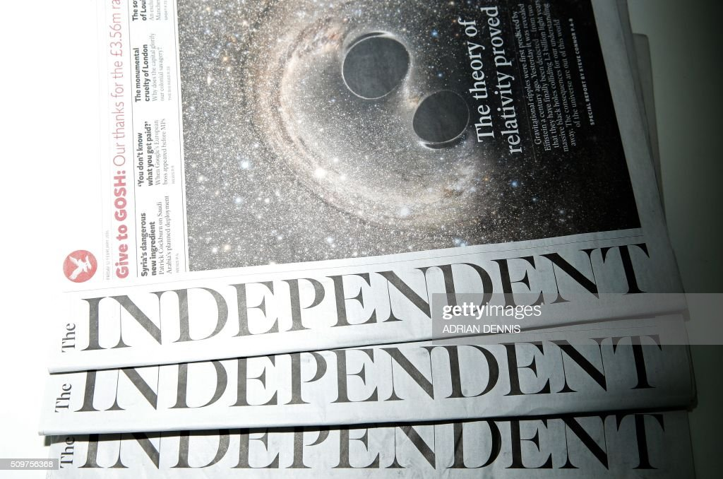Copies of the British newspaper 'The Independent' are arranged for a photograph in London on February 12, 2016. British newspaper The Independent will become digital only, and its last print edition will come out on March 26, owners ESI Media said in a statement. / AFP / ADRIAN DENNIS