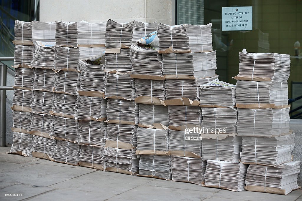Copies of the Evening Standard newspaper are stacked up outside Cannon Street railway station next to a sign prohibiting the leaving of newspapers in the vicinity on January 25, 2013 in London, England.