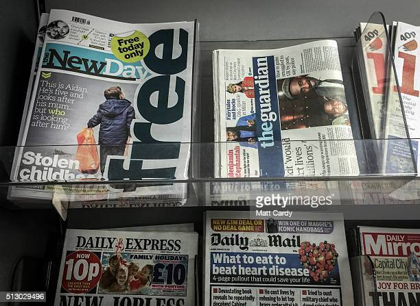 Copies of the first edition of the New Day newspaper are displayed alongside other UK national daily newspaper titles in a newsagent on February 29...