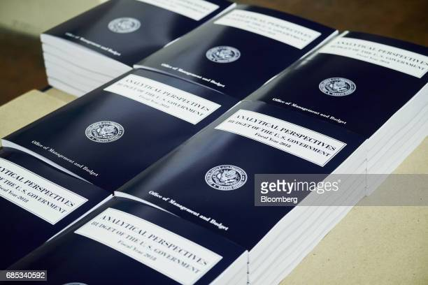 Copies of the fiscal year 2018 budget sit on display inside the Government Publishing Office production facility in Washington DC US on Friday May 19...