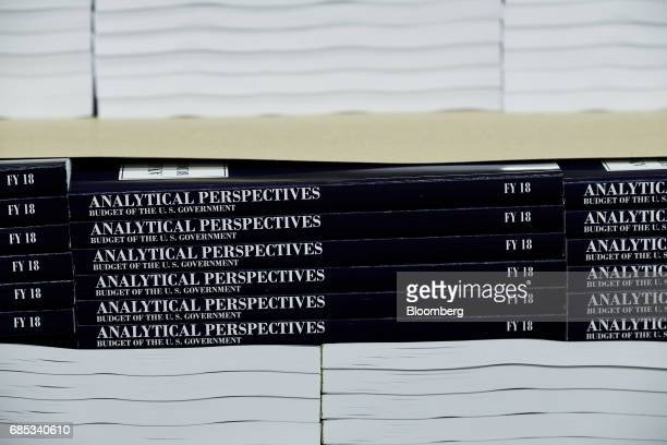 Copies of the fiscal year 2018 budget sit stacked inside the Government Publishing Office production facility in Washington DC US on Friday May 19...