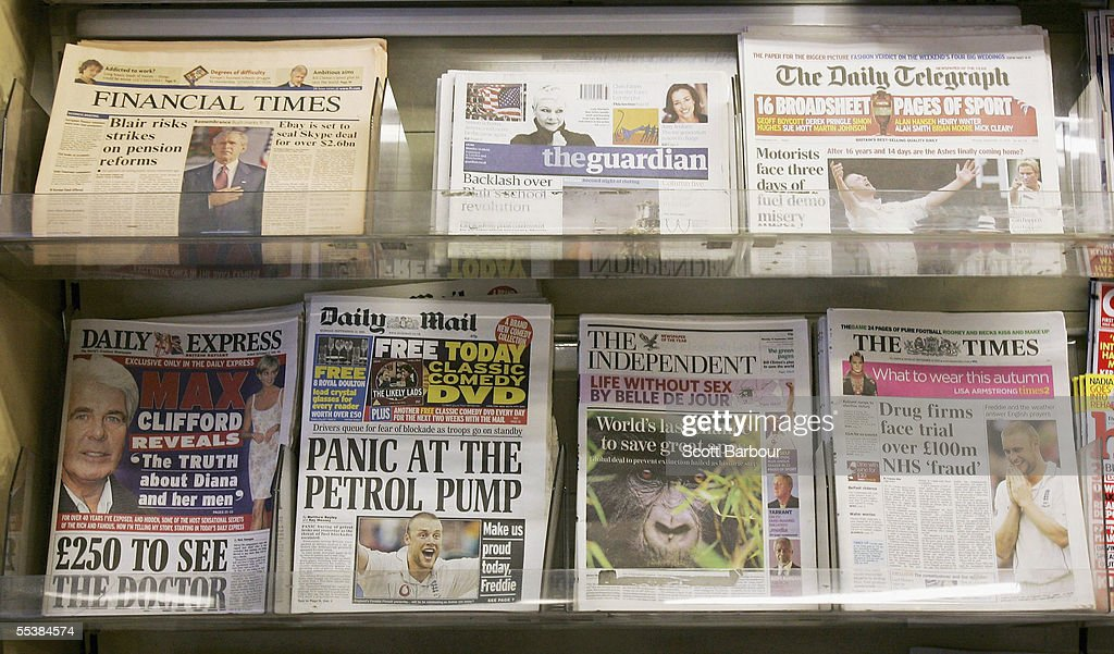 Copies of The Guardian newspaper sit on display along with other British newspapers at a newsagents on September 12, 2005 in London, England. The Guardian has relaunched, changing from a broadsheet to mid-size format. The size, known as the Berliner, is half-way between a tabloid and a broadsheet.