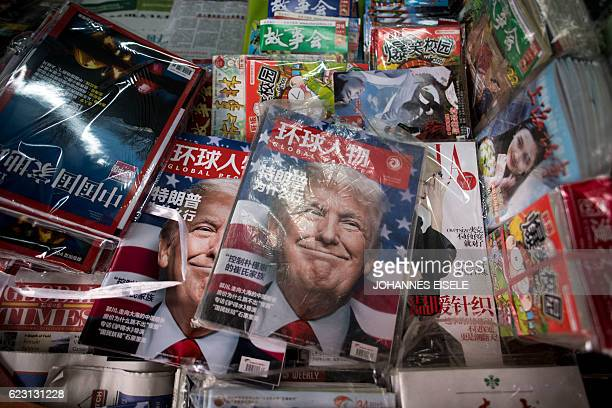 Copies of the local Chinese magazine Global People with a cover story that translates to 'Why did Trump win' is seen with a front cover portrait of...