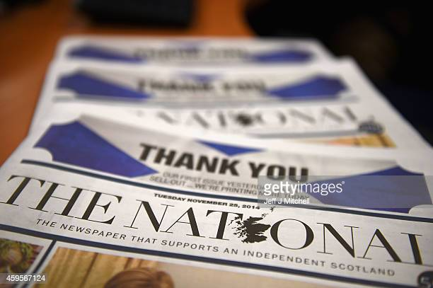 Copies of 'The National' are displayed as staff work in the newsroom after its yesterday's launch on November 25 2014 in Glasgow Scotland The...