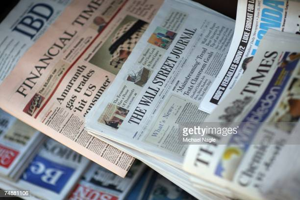 Copies of the Wall Street Journal and other news papers sit on display at a newsstand on Exchange Place on June 25 2007 in New York City Negotiations...
