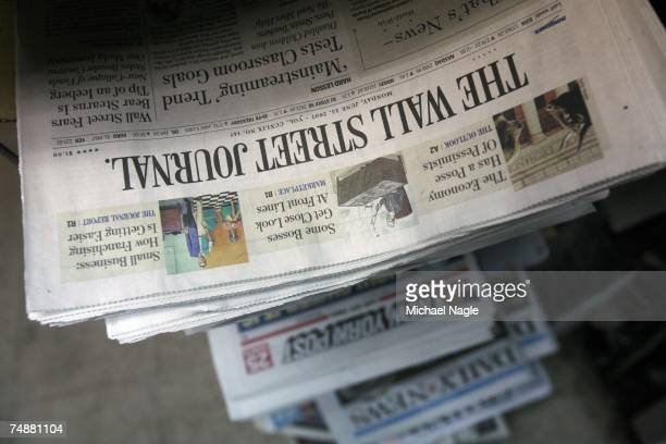 Copies of the Wall Street Journal and the New York Post sit on display at a newsstand in Lower Manhattan on June 25 2007 in New York City...