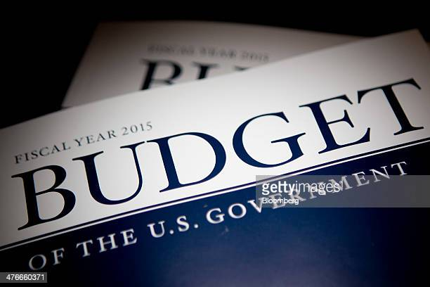 Copies of US President Barack Obama's Fiscal Year 2015 Budget are arranged for a photograph in Washington DC US on Tuesday March 4 2014 Obama sent...