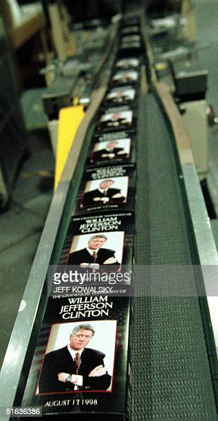 Copies of US President Bill Clinton's grand jury testimony head towards the shrink wrap machine at Premiere Video duplication facility in Livonia MI...