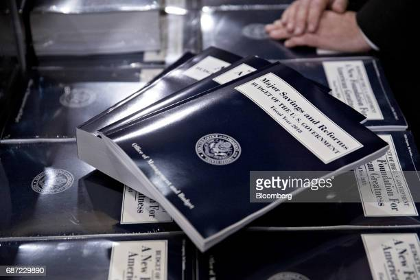 Copies of US President Donald Trump's fiscal 2018 budget proposal sit on display in the Senate Budget Committee hearing room on Capitol Hill in...