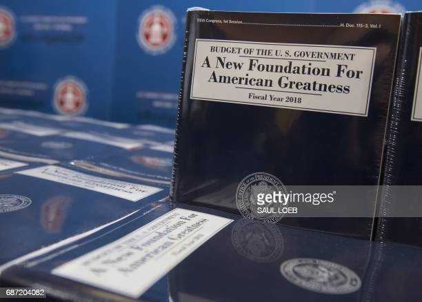 Copies of US President Donald Trump's Fiscal Year 2018 budget are released for distribution on Capitol Hill in Washington DC May 23 2017 / AFP PHOTO...