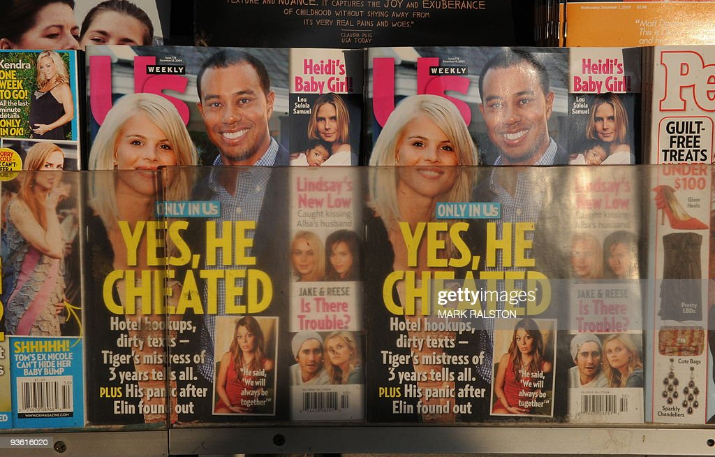 Copies of Us Weekly magazine featuring the story on Tiger Woods and the interview with alleged mistress Jaimee Grubbs are seen for sale on the newstands in Beverly Hills on December 2, 2009. Tiger Woods apologized for 'transgressions' in his family life as the magazine posted what it said was evidence of an extramarital affair between the golf superstar and a cocktail waitress. It came hours after the celebrity magazine Us Weekly posted an online recording of what it said was Woods begging Los Angeles waitress Jaimee Grubbs to change her voicemail to hide their affair from his wife Erin. AFP PHOTO/Mark RALSTON