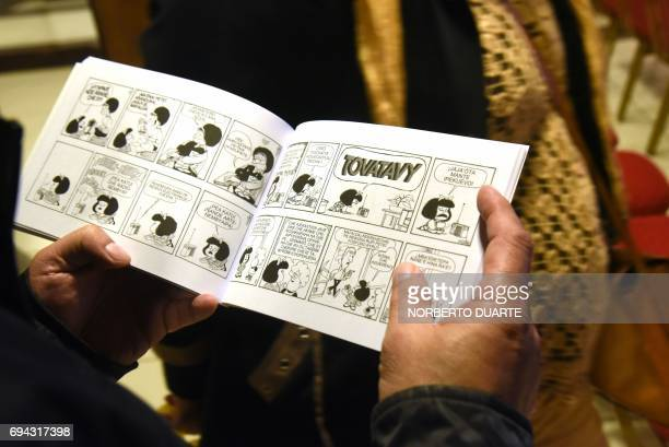 Copies on display of the first translation to Paraguay's second language Guarani of Quino's world famous comic Mafalda during its launching in...