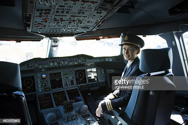Copilot Angelika Barufke poses in the cockpit of an Airbus A380 from Emirates airlines during the International Air Show ILA in Schoenefeld near...