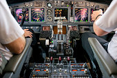 Co-pilot or first officer is flying commercial airplane Boeing 737-800.