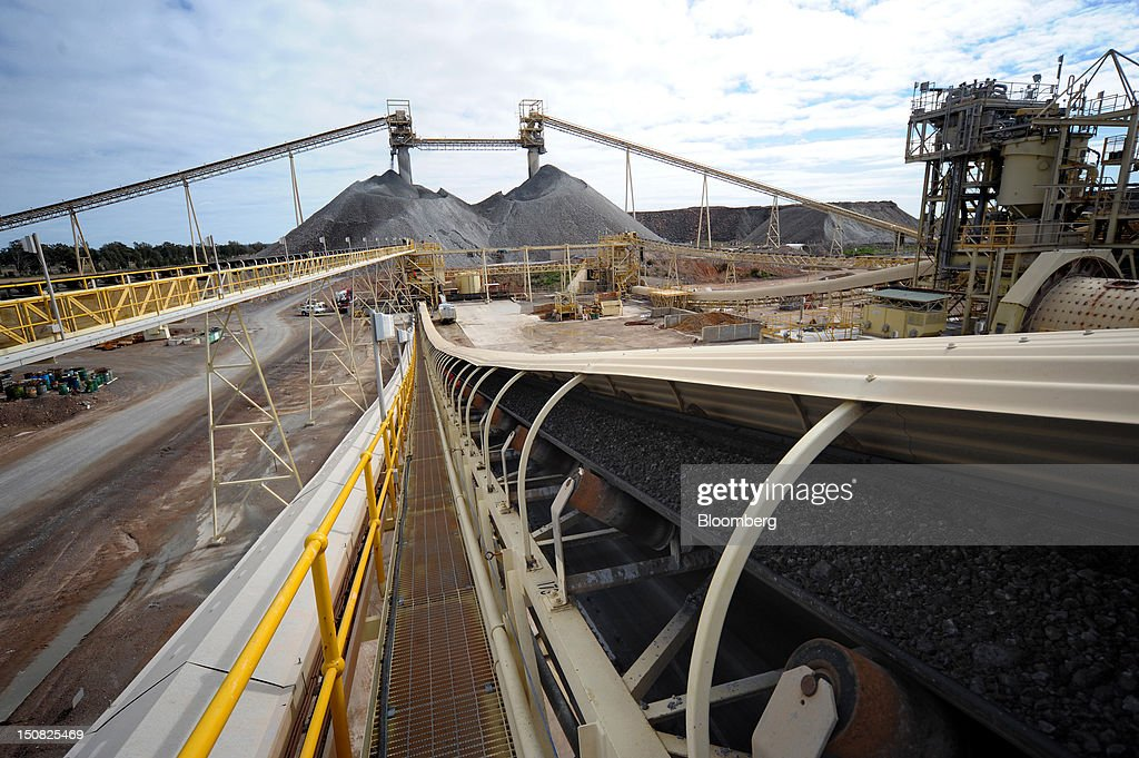 Copper ore moves along a conveyor belt from a stockpile before being ground at the processing plant of Rio Tinto Group's Northparkes copper and gold underground block cave mine in Parkes, New South Wales, Australia, on Friday, Aug. 24, 2012. Northparkes last year produced 50,000 tons of copper. Rio owns 80 percent of the operation and Sumitomo Corp., the remainder. Photographer: Carla Gottgens/Bloomberg via Getty Images
