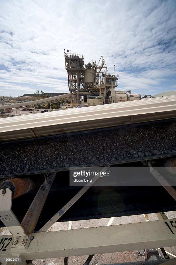 Copper ore moves along a conveyor belt from a stockpile to the grinding facility at the processing plant of Rio Tinto Group's Northparkes copper and gold underground block cave mine in Parkes, New South Wales, Australia, on Friday, Aug. 24, 2012. Northparkes last year produced 50,000 tons of copper. Rio owns 80 percent of the operation and Sumitomo Corp., the remainder. Photographer: Carla Gottgens/Bloomberg via Getty Images