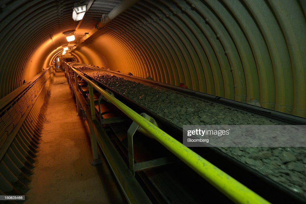 Copper ore travels along a conveyor belt at the processing plant of Rio Tinto Group's Northparkes copper and gold underground block cave mine in Parkes, New South Wales, Australia, on Friday, Aug. 24, 2012. Northparkes last year produced 50,000 tons of copper. Rio owns 80 percent of the operation and Sumitomo Corp., the remainder. Photographer: Carla Gottgens/Bloomberg via Getty Images
