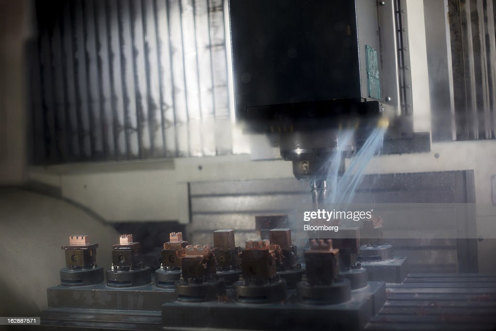 Copper pieces used for injection molding are cooled down with water at the Motherson Sumi Systems Ltd. (MSSL) injection molding plant in Noida, India, on Thursday, Feb. 28, 2013. Motherson Sumi Systems Ltd., 25 percent owned by Sumitomo Electric Industries Ltd. and India's biggest auto parts maker, supplies rear view mirrors, bumpers and body panels to clients including Porsche Automobil Holding SE, Bayerische Motoren Werke AG and Volkswagen AG. Photographer: Brent Lewin/Bloomberg via Getty Images