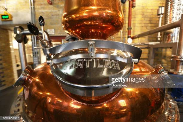 A copper still operates at The London Distillery Company Ltd plant in London UK on Thursday April 24 2014 UK manufacturing confidence rose to the...
